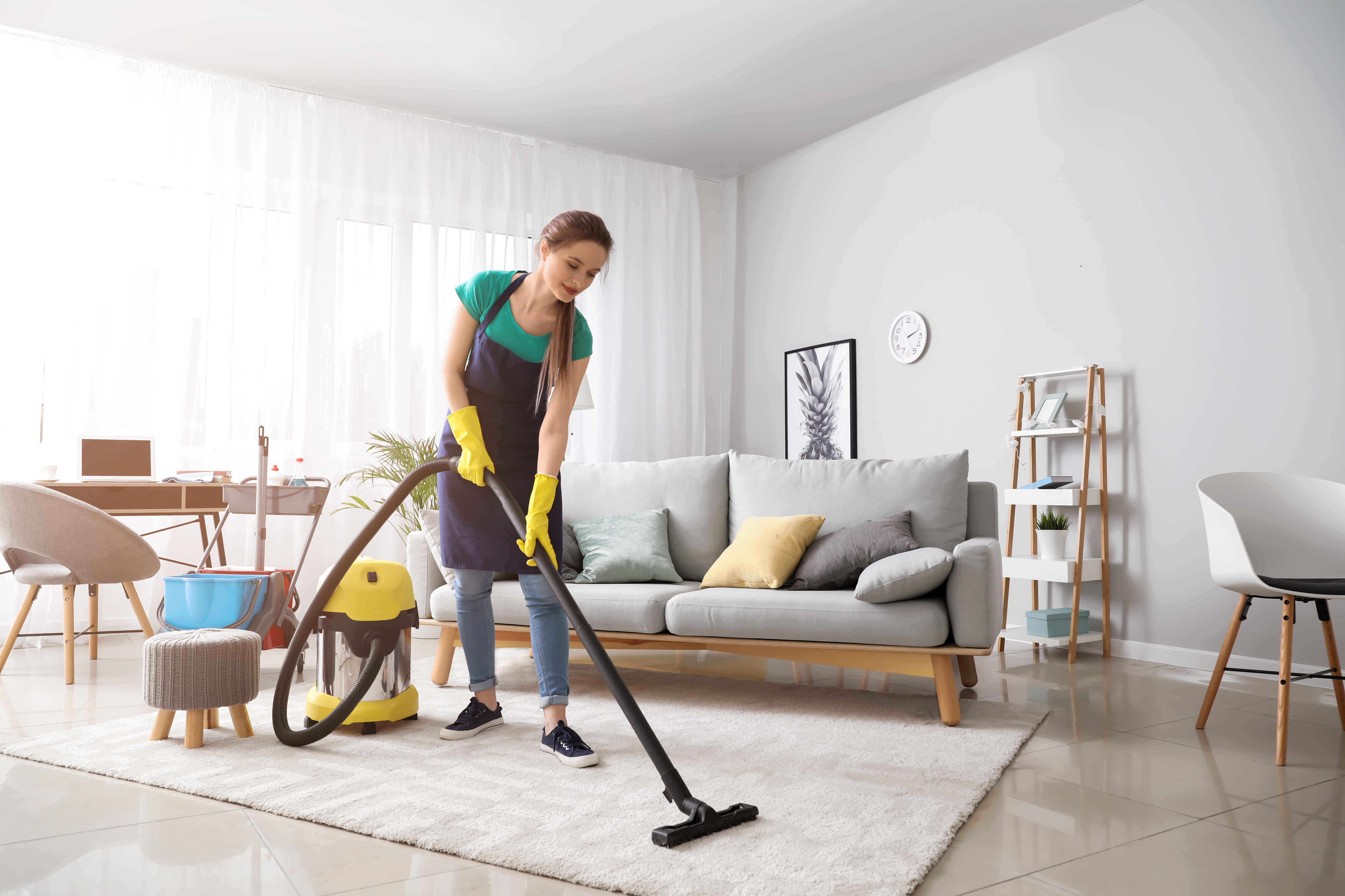 A smiling professional carpet cleaner