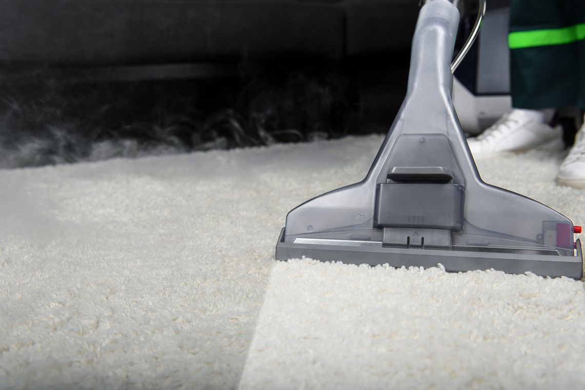 deep carpet clean with a vacuum on a dusty carpet